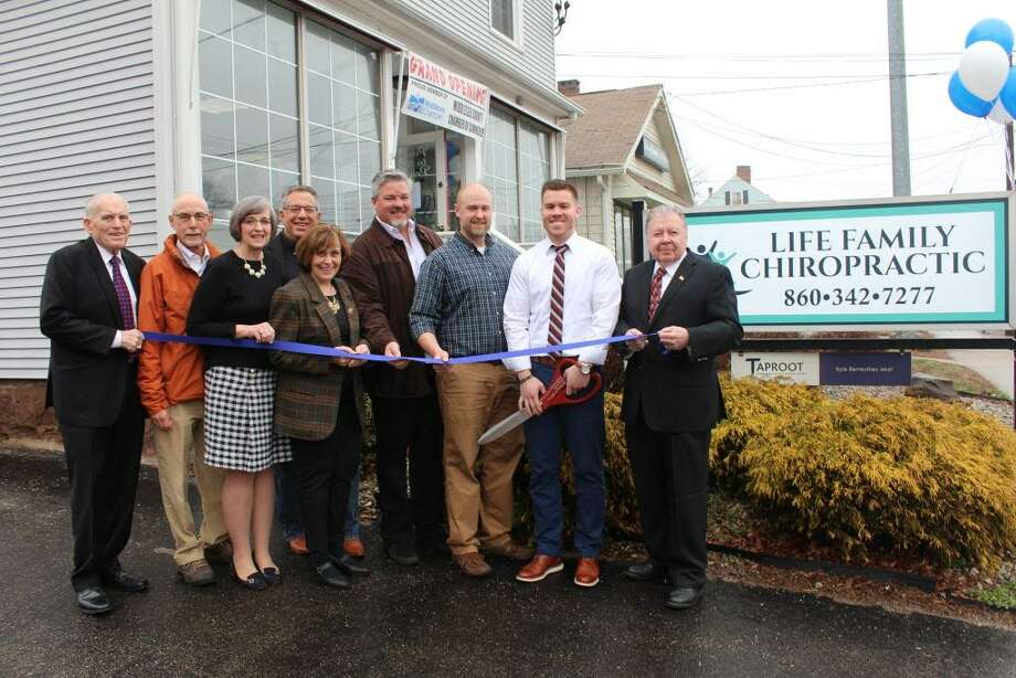 Life Family Chiropractic of Portland held a grand opening April 4 at 234 Main St, Portland. From left are Middlesex County Chamber of Commerce President Larry McHugh, Portland Selectman Rick Sharr, Economic Development Consultant Mary Dickerson, Dr. John Mormile, First Selectman Susan Bransfield, Drs. Stephen Judson, Michael Koster and Tyler Hartley, and Chamber Vice Chairman Jay Polke. Photo: Contributed Photo