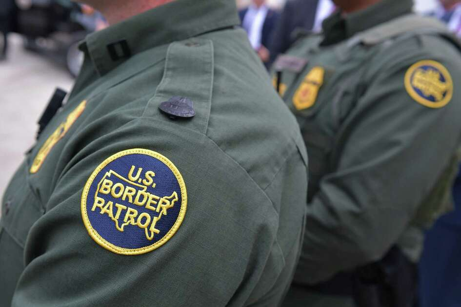 Members of the US Border Patrol listen as US President Donald Trump speaks after inspecting border wall prototypes  in San Diego, California on March 13, 2018. / AFP PHOTO / MANDEL NGANMANDEL NGAN/AFP/Getty Images