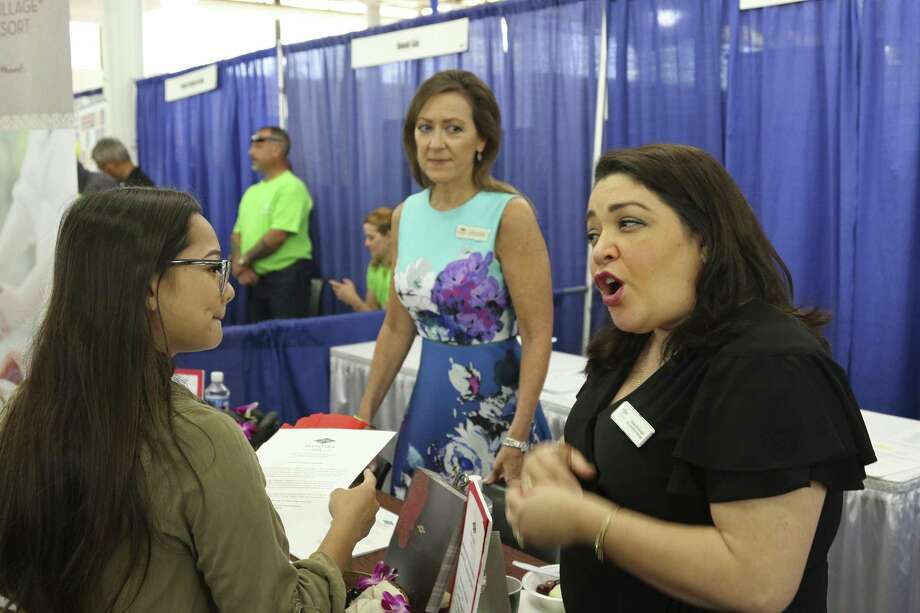 Roxy Creed, left, speaks to Mandara Spa Operations Manager Lena Andrade about employment opportunities at a job fair in Honolulu. Photo: Audrey McAvoy, STF / Associated Press / Copyright 2018 The Associated Press. All rights reserved.