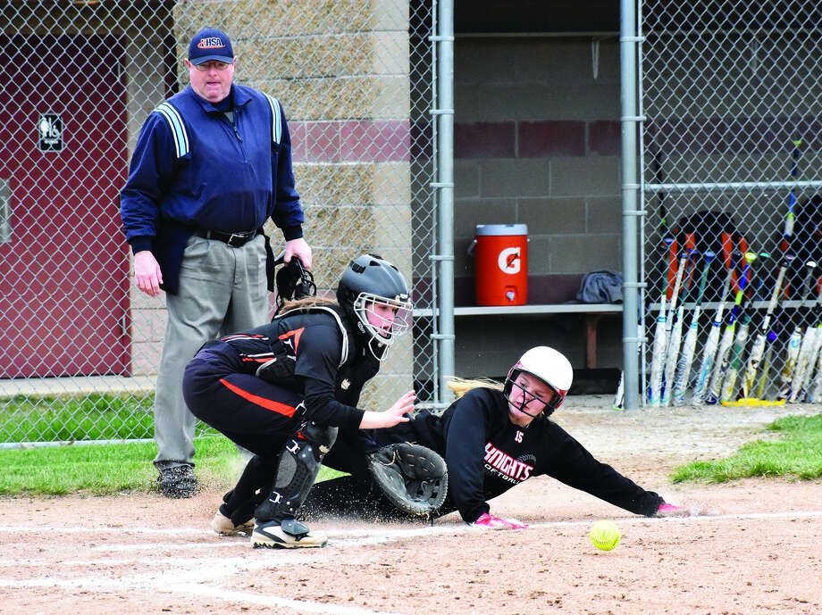 Edwardsville catcher Lauren Tripp waits for the throw to arrive before trying to tag out a Triad runner at home plate during the second inning of Friday's non-conference game in Troy.