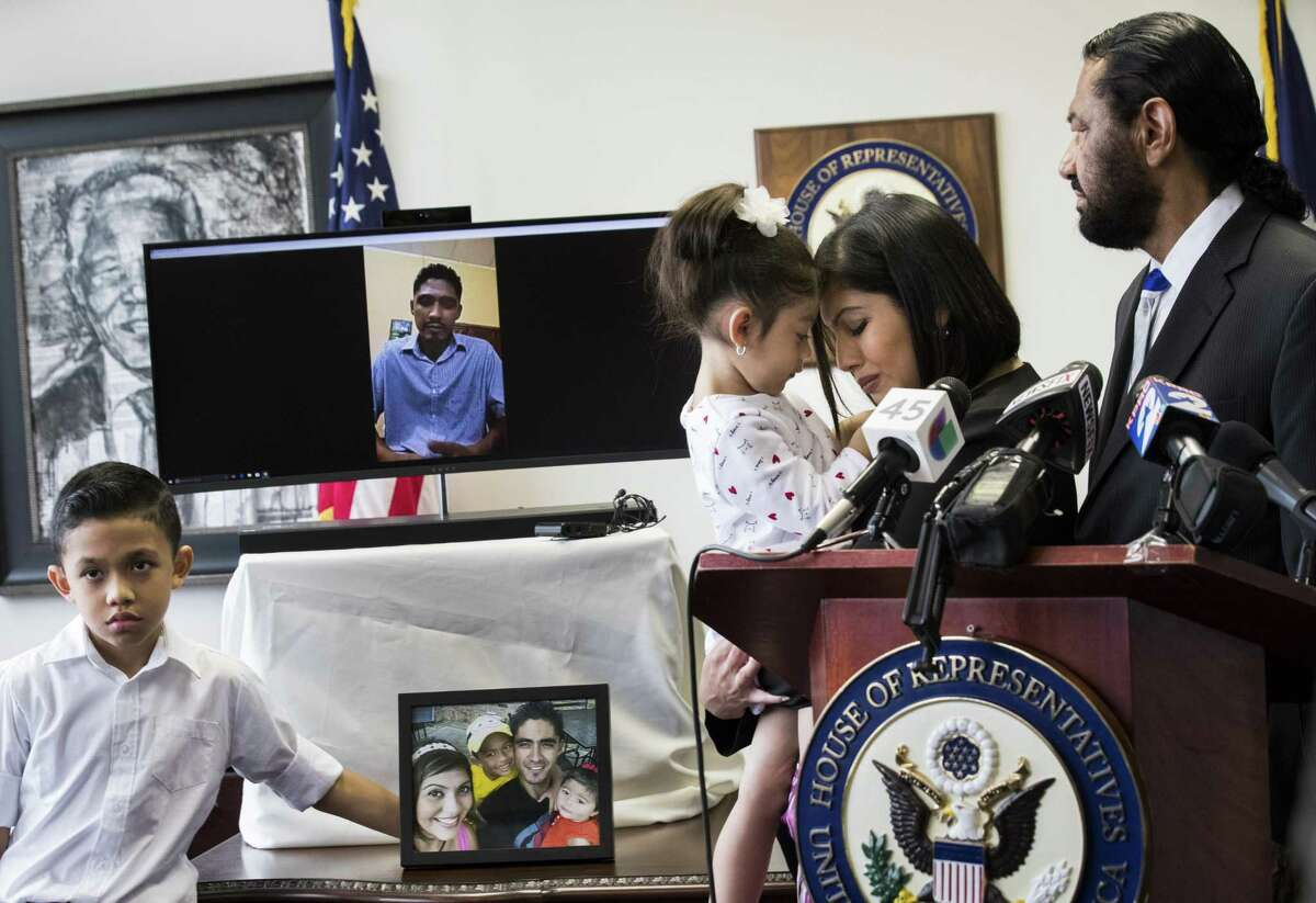 Carmen Escobar, 3, and her mother Rose Escobar share a moment while Rose's husband Jose Escobar speaks to the press live from El Salvador during an announcement by Congressman Al Green (TX-09) on which the congressman announced a plan to introduce The Reentry and Reunification Act of 2018, Friday, April 6, 2018, in Houston. ( Marie D. De Jesus / Houston Chronicle )