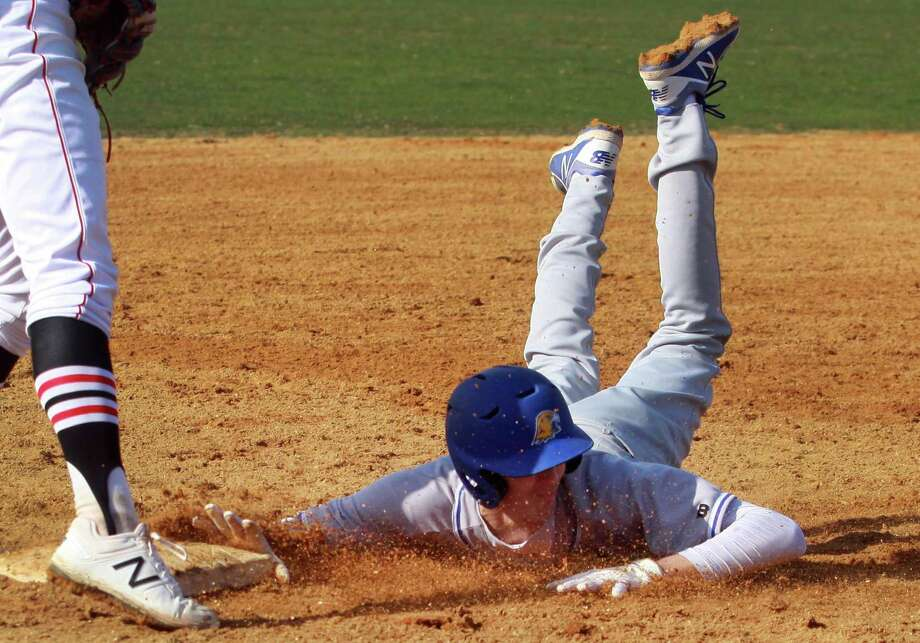 Newtown's Todd Petersen slides into third base during baseball action against Fairfield Warde in Fairfield, Conn., on Friday Apr. 6, 2018. Photo: Christian Abraham / Hearst Connecticut Media / Connecticut Post