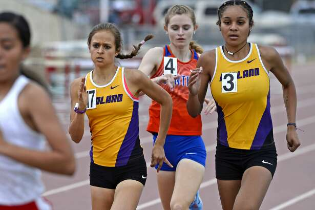 Midland High juniors Kandus Box, left, and Jenia Mitchell, right, compete in the girls 800 meter race during the District 2-6A track meet April 6, 2018, at Memorial Stadium. James Durbin/Reporter-Telegram