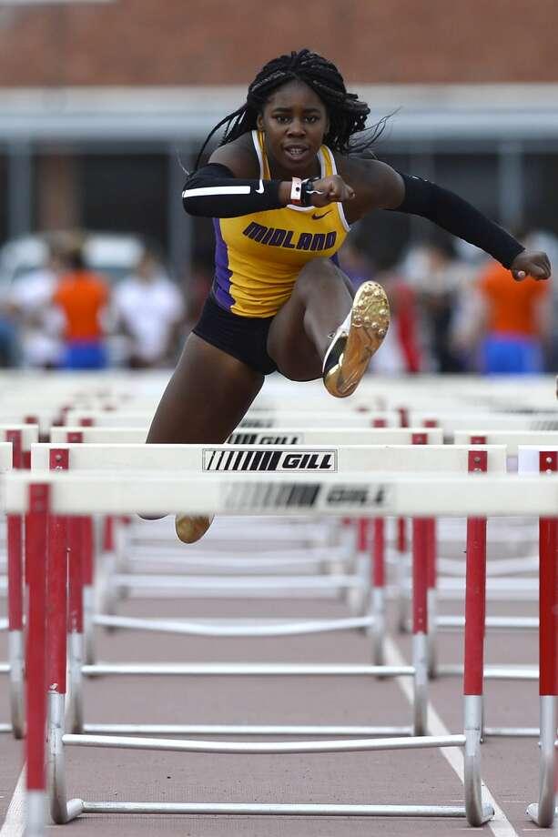 Midland High's Sametria Smith competes in the Varsity girls 100 meter hurdles during the District 2-6A track meet April 6, 2018, at Memorial Stadium. James Durbin/Reporter-Telegram Photo: James Durbin
