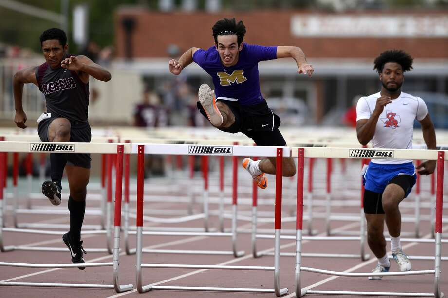 Midland High's Jacob McCracken competes in the varsity boys 110 meter hurdles during the District 2-6A track meet April 6, 2018, at Memorial Stadium. James Durbin/Reporter-Telegram Photo: James Durbin
