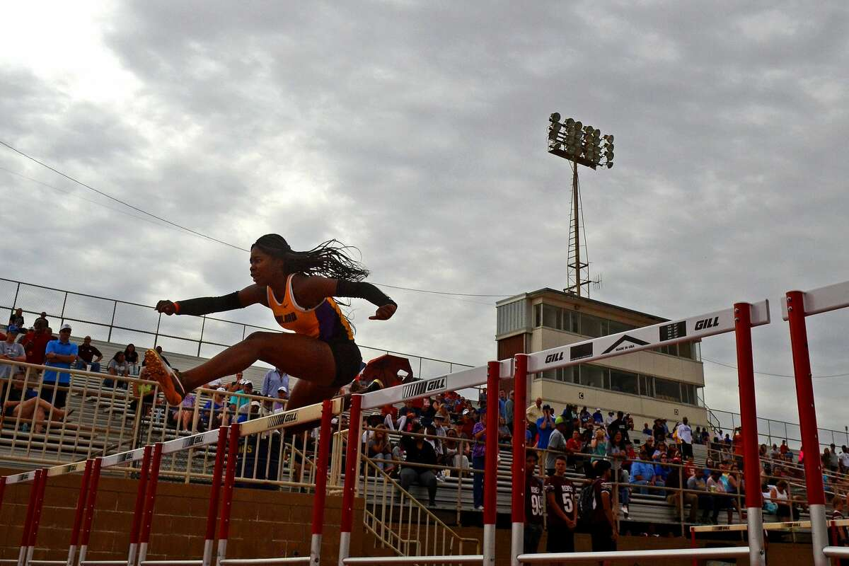 Midland High's Sametria Smith competes in the Varsity girls 100 meter hurdles during the District 2-6A track meet April 6, 2018, at Memorial Stadium. James Durbin/Reporter-Telegram