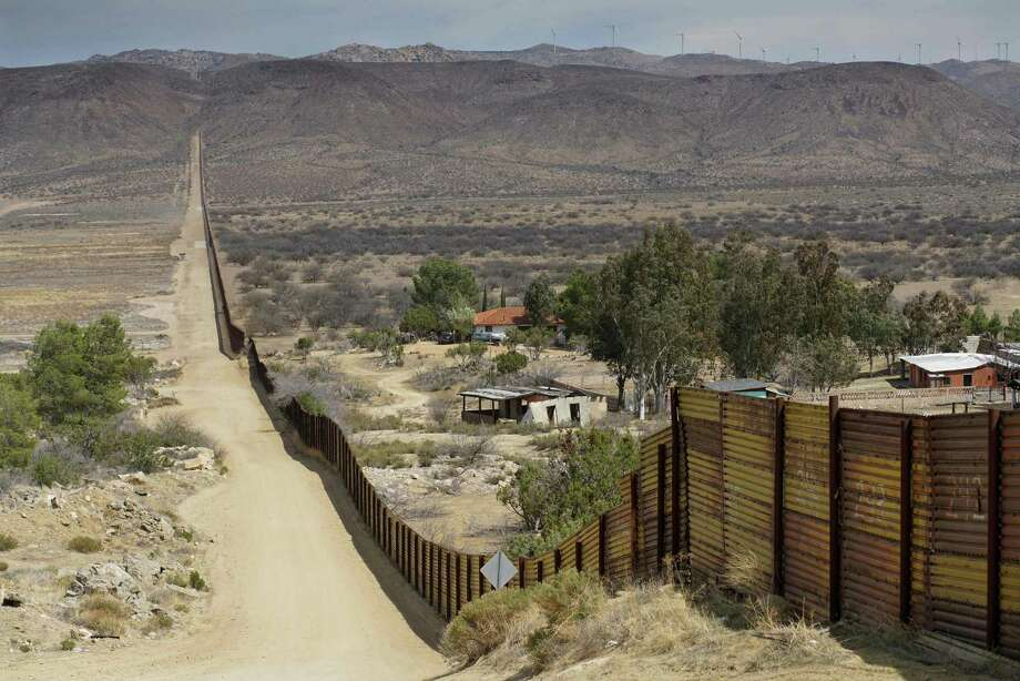 """Houses are seen on the Mexican side of the US/ Mexico border fence on April 6, 2018 in Jacumba, California.  US President Donald Trump on April 5, 2018 said he would send thousands of National Guard troops to the southern border, amid a widening spat with his Mexican counterpart Enrique Pena Nieto. The anti-immigration president said the National Guard deployment would range from 2,000 to 4,000 troops, and he would """"probably"""" keep many personnel on the border until his wall is built -- spelling out a lengthy mission.  / AFP PHOTO / Sandy HuffakerSANDY HUFFAKER/AFP/Getty Images Photo: SANDY HUFFAKER, Contributor / AFP or licensors"""