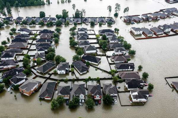 A neighborhood is inundated by floodwaters from Tropical Storm Harvey on Tuesday, Aug. 29, 2017, in Spring. ( Brett Coomer / Houston Chronicle )