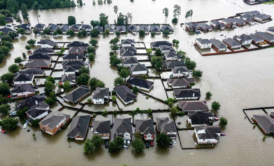A neighborhood is inundated by floodwaters from Tropical Storm Harvey. Texas receives 96 cents in claims payments for every dollar it spends on flood insurance, according to a new analysis. ( Brett Coomer / Houston Chronicle ) Photo: Brett Coomer, Staff / Houston Chronicle / © 2017 Houston Chronicle