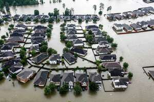 A neighborhood is inundated by floodwaters from Tropical Storm Harvey on Aug. 29, 2017, in Spring.