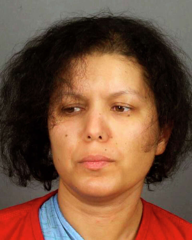 "This booking photo, released Friday April 6, 2018 by the Monroe County Sheriff's Office, shows Hanane Mouhib after her arrest in connection with the death of her 7-year-old son Abraham Cardenas on Thursday evening at their home in the town of Sweden, about 15 miles west of Rochester in rural New York. Authorities said Mouhib used a ""large-bladed kitchen knife"" to sever the head of her son 10 days after she was released from a hospital mental health unit. She was arraigned on murder charges Friday and held without bail. (Monroe County Sheriff's Office via AP) / Monroe County Sheriff's Office"