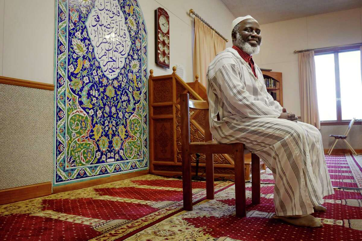 Imam Abdul-Rahman Yaki poses in the prayer room at the Islamic Center of the Capital District on Wednesday, April 4, 2018, in Colonie, N.Y. (Paul Buckowski/Times Union)