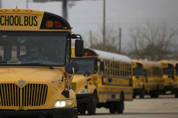 A line of Houston ISD school buses leaves a facility on Pinemont Drive in Houston on Jan. 8, 2015, in Houston. ( Johnny Hanson / Houston Chronicle )