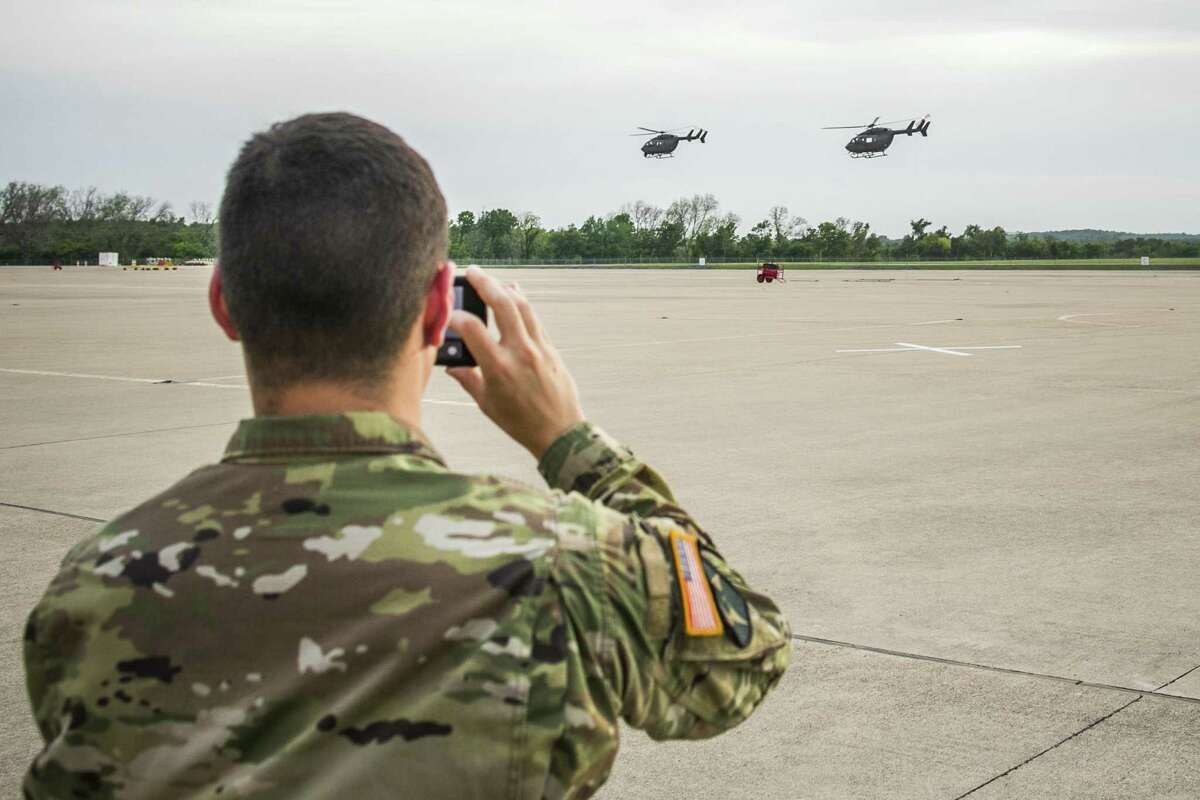 Texas National Guard helicopters traveling to the Texas-Mexico border fly off on April 6, 2018 in Austin, Texas. Brigadier General Tracy Norris announced during a press conference that the Texas National Guard will deploy an expected 250 personnel to the border with supporting aircraft, vehicles and equipment within 72 hours. (Photo by Drew Anthony Smith/Getty Images)