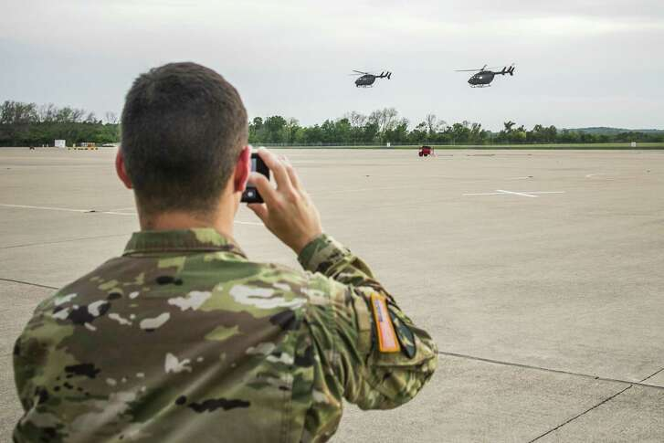 AUSTIN, TX - APRIL 06: Texas National Guard helicopters traveling to the Texas-Mexico border fly off on April 6, 2018 in Austin, Texas. Brigadier General Tracy Norris announced during a press conference that the Texas National Guard will deploy an expected 250 peronnel to the border with supporting aircraft, vehicles and equipment within 72 hours. (Photo by Drew Anthony Smith/Getty Images)