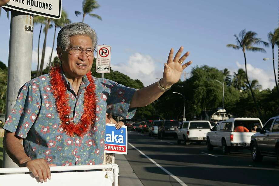 Campaigning for re-election in 2006, Sen. Daniel Akaka waves to commuters driving by in Honolulu. Photo: Marco Garcia / Associated Press 2006
