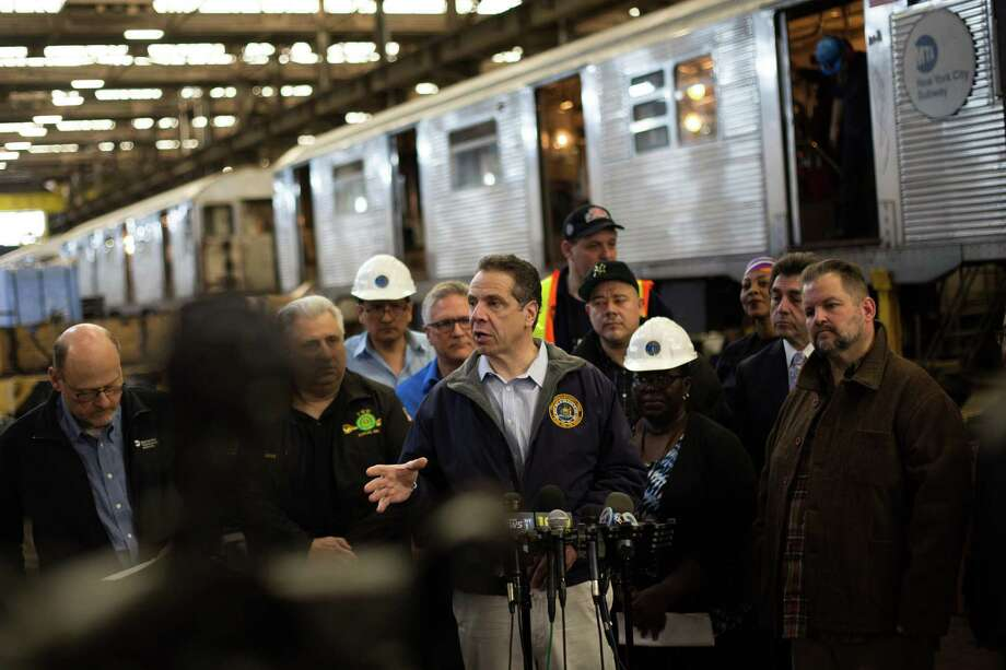 NEW YORK, NY - APRIL 6: New York Governor Andrew Cuomo addresses the press following a tour of the MTA's 207th St. overhaul shop and train yard on April 6, 2018 in New York City. Cuomo recently celebrated meeting a funding goal for an emergency action plan to fix New York City's subways. (Photo by Kevin Hagen/Getty Images) Photo: Kevin Hagen / 2018 Getty Images