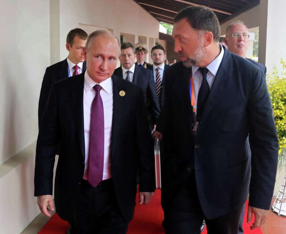 Oleg Deripaska, right, an associate of Russia President Vladimir Putin has been ensnared in the ongoing investigation of Russian influence in the 2016 presidential elections. Photo: Mikhail Klimentyev, POOL / Associated Press / POOL SPUTNIK KREMLIN