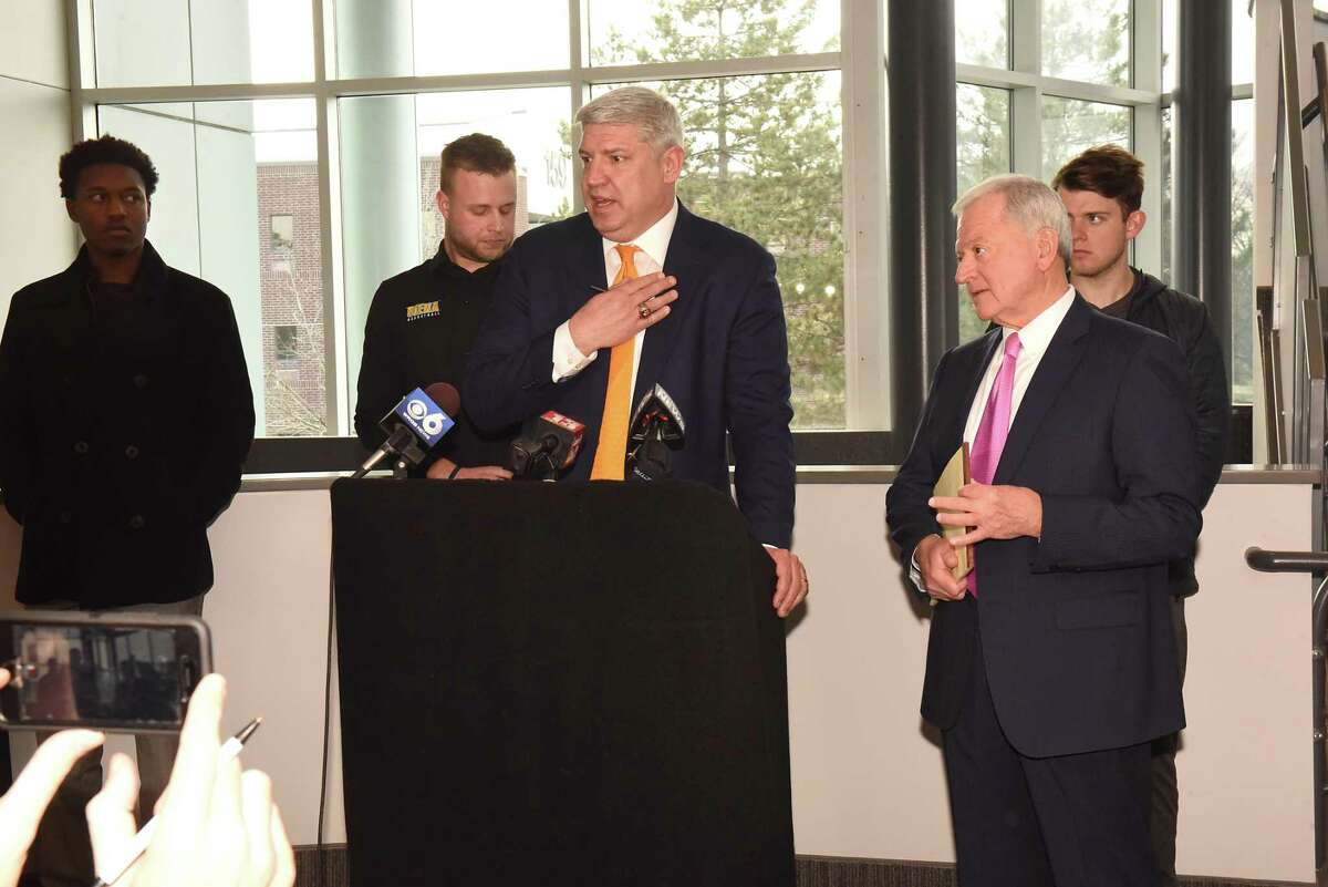 Siena men's basketball coach Jimmy Patsos, center, and his attorney Dick Walsh, second from right, hold a news conference at Lombardi, Walsh, Davenport, Amodeo law firm to address reports that Patsos verbally abused a team manager on Friday, April 6, 2018 in Colonie, N.Y. Standing behind them are his former team managers Wesley Douglas, left, Robert Sherlock, center, and Robert McCarthy. (Lori Van Buren/Times Union)