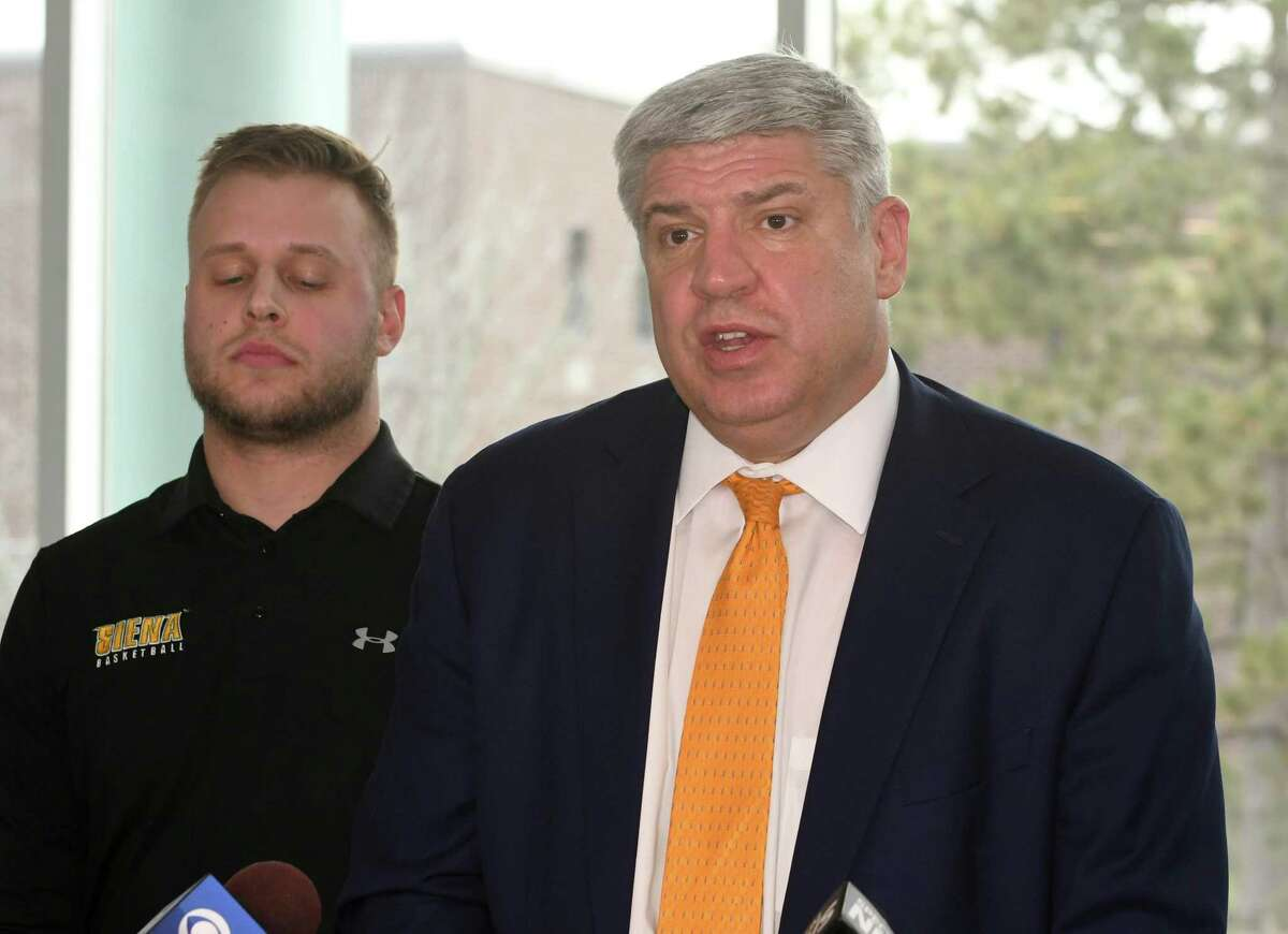 Siena men's basketball coach Jimmy Patsos holds a news conference at Lombardi, Walsh, Davenport, Amodeo law firm to address reports that he verbally abused a team manager on Friday, April 6, 2018 in Colonie, N.Y. Former team manager Robert Sherlock stands behind him. (Lori Van Buren/Times Union)
