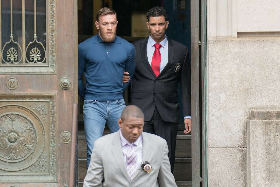 Boxer Conor McGregor is taken from the 78th Precinct in Brooklyn on Friday April 6, 2018. (Theodore Parisienne/New York Daily News/TNS) Photo: Theodore Parisienne, TNS