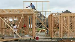 A construction crew works on a new home at Elyson, a new master-planned community in the northwest Harris County, Friday, April 6, 2018, in Katy, Texas. The developer of Elyson was undaunted by the risks posed by three flood plains that traverse the 3,600-acre property. ( Godofredo A. Vasquez / Houston Chronicle )