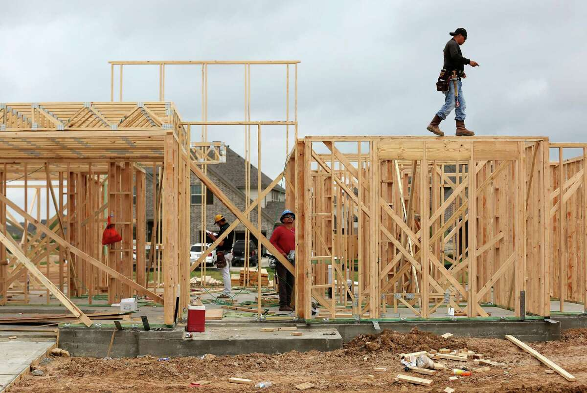 A construction crew frames a house in Elyson, a master-planned community developed by Newland Communities in the Katy area. Newland has just been acquired by Brookfield Residential.