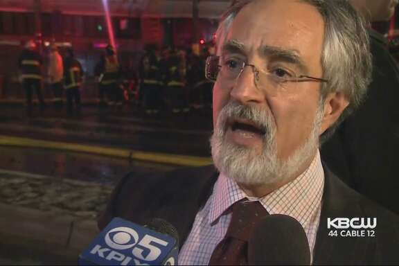 San Francisco Supervisor Aaron Peskin speaks to reporters at the scene of a major fire in North Beach on March 17. Fire Department officials said in internal memos that he appeared to be intoxicated, which Peskin has denied.