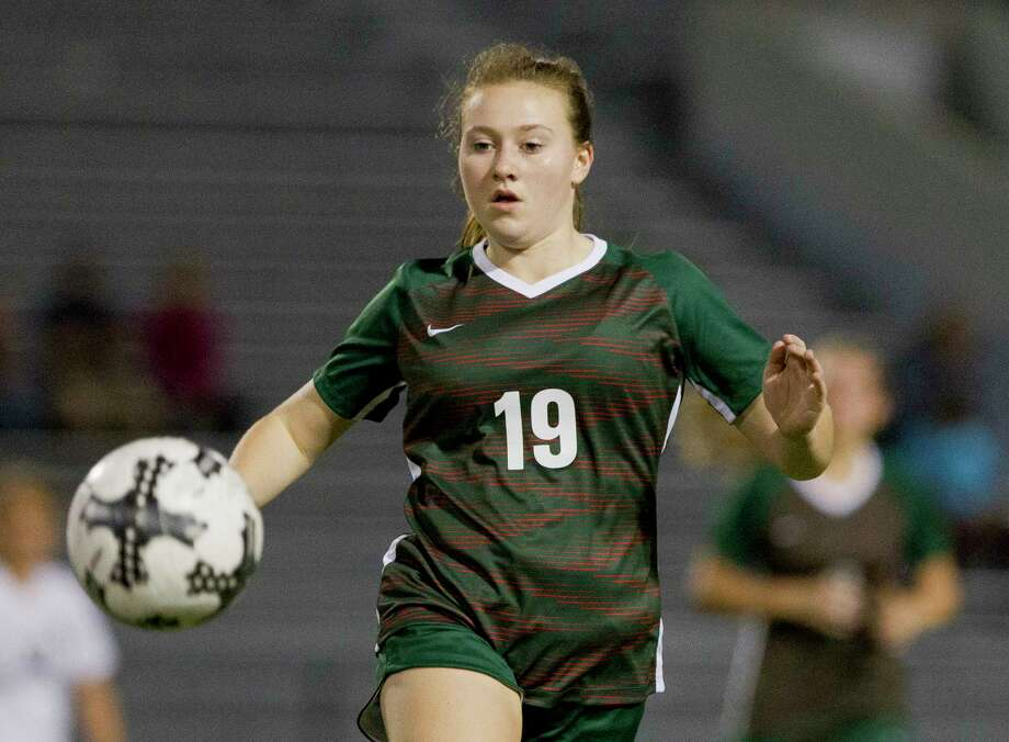 The Woodlands midfielder Grace Stine (19) chases down the ball during the second period of a District 12-6A high school soccer match at Buddy Moorhead Stadium, Thursday, Feb. 15, 2018, in Conroe. Photo: Jason Fochtman, Staff Photographer / © 2018 Houston Chronicle