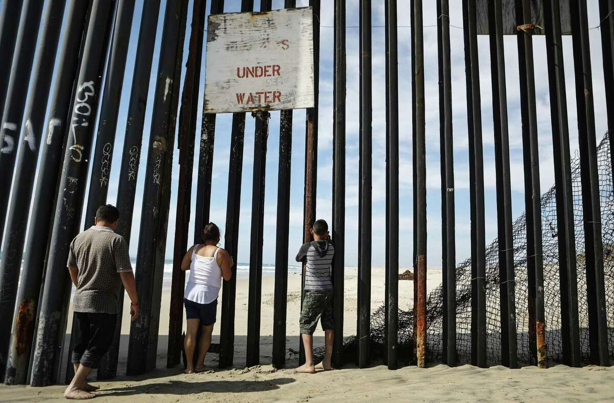 TIJUANA, MEXICO - APRIL 05: People gaze through the border fence towards the U.S. while on the beach at the U.S.-Mexico border on April 5, 2018 in Tijuana, Mexico. President Trump has issued a decree for the National Guard to guard the 3,200 kilometer border between the United States and Mexico.
