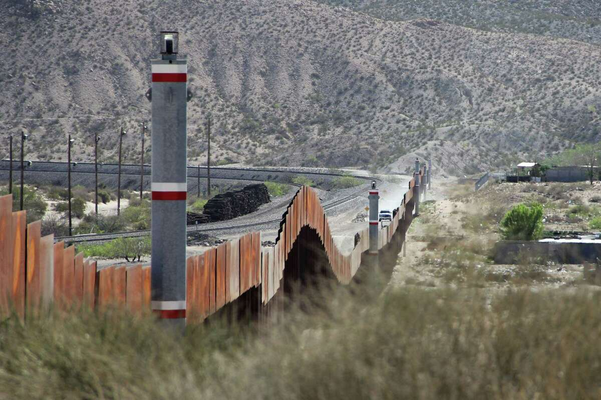 TOPSHOT - The U.S. border patrol keeps watch in El Paso, Texas State, in the United States as seen from across the US-Mexico border fence in the Anapra valley near Ciudad Juarez, Chihuahua State, Mexico, on April 5, 2018.