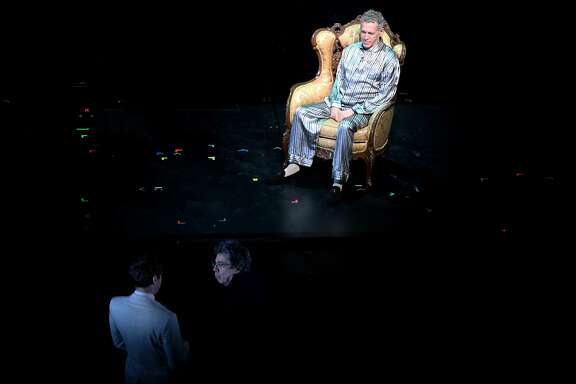 """From right: Stephen Spinella (playing Roy Cohn) as director Tony Taccone chats off stage during rehearsal of """"Angels in America"""" at Berkeley Rep's Roda Theatre, Thursday, April 5, 2018, in San Francisco, Calif."""