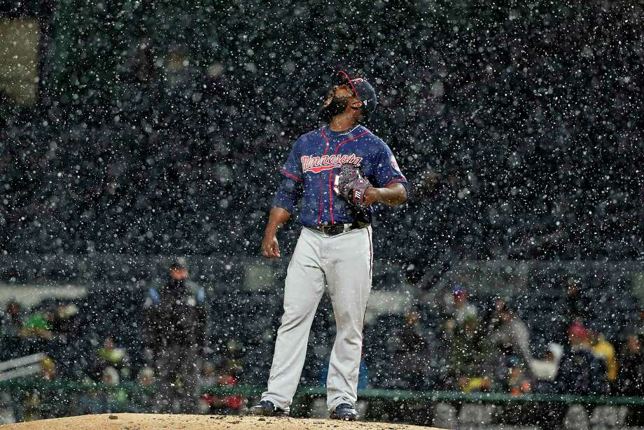 Minnesota Twins relief pitcher Fernando Rodney stands on the mound during a snow squall in the ninth inning of the team's baseball game against the Pittsburgh Pirates in Pittsburgh, Wednesday, April 4, 2018. The Twins won 7-3. (AP Photo/Gene J. Puskar) Photo: Gene J. Puskar / Copyright 2018 The Associated Press. All rights reserved.