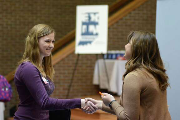 Indiana Wesleyan University senior Courtney Kingma, left, thanks Jennie Hehe, community resource manager for Tangram, for talking with her during the Experience Indiana job fair event in the student center at IWU in Marion, Ind.