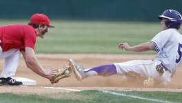 Boerne's Douglas Hodo steals third around Fredericksburg's Don Flannery during the first inning Friday April 6, 2018 at Greyhound Field in Boerne, Tx.