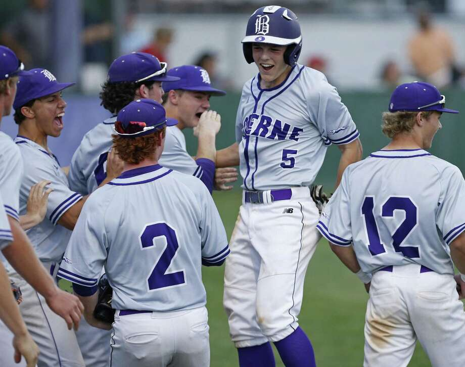 Boerne's Douglas Hodo (center) celebrates with teammates after scoring against Fredericksburg during the second inning Friday April 6, 2018 at Greyhound Field in Boerne, Tx. Photo: Edward A. Ornelas, Staff / San Antonio Express-News / © 2018 San Antonio Express-News