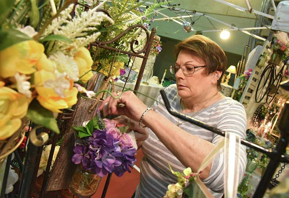 Karen Rutledge of New Jersey sets up the area for her business Karen's Country Collectables for the County Folk Art Craft Show at McDonough Sports Complex on Friday, April 6, 2018 in Troy, N.Y. (Lori Van Buren/Times Union) Photo: Lori Van Buren / 20043421A
