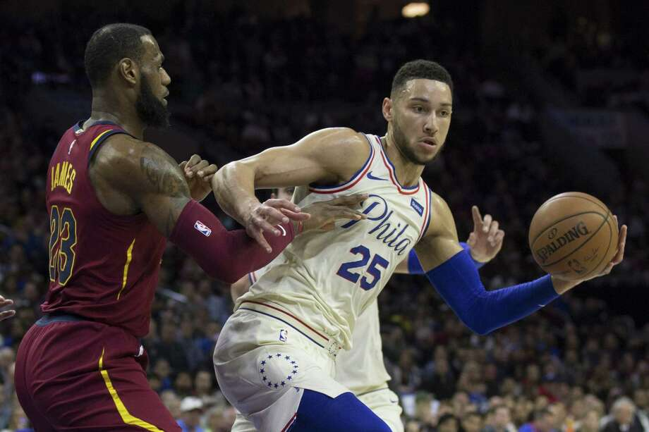 PHILADELPHIA, PA - APRIL 6: Ben Simmons #25 of the Philadelphia 76ers controls the ball against LeBron James #23 of the Cleveland Cavaliers in the first quarter at the Wells Fargo Center on April 6, 2018 in Philadelphia, Pennsylvania. NOTE TO USER: User expressly acknowledges and agrees that, by downloading and or using this photograph, User is consenting to the terms and conditions of the Getty Images License Agreement. (Photo by Mitchell Leff/Getty Images) Photo: Mitchell Leff / 2018 Getty Images