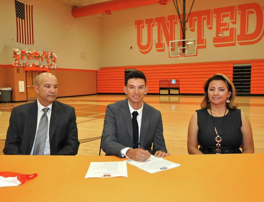 Accompanied by his parents Mario and Ilda Martinez, Adrian Martinez signed his National Letter of Intent on Friday to attend McPherson College for baseball next year. Photo: Courtesy Of UISD Athletics