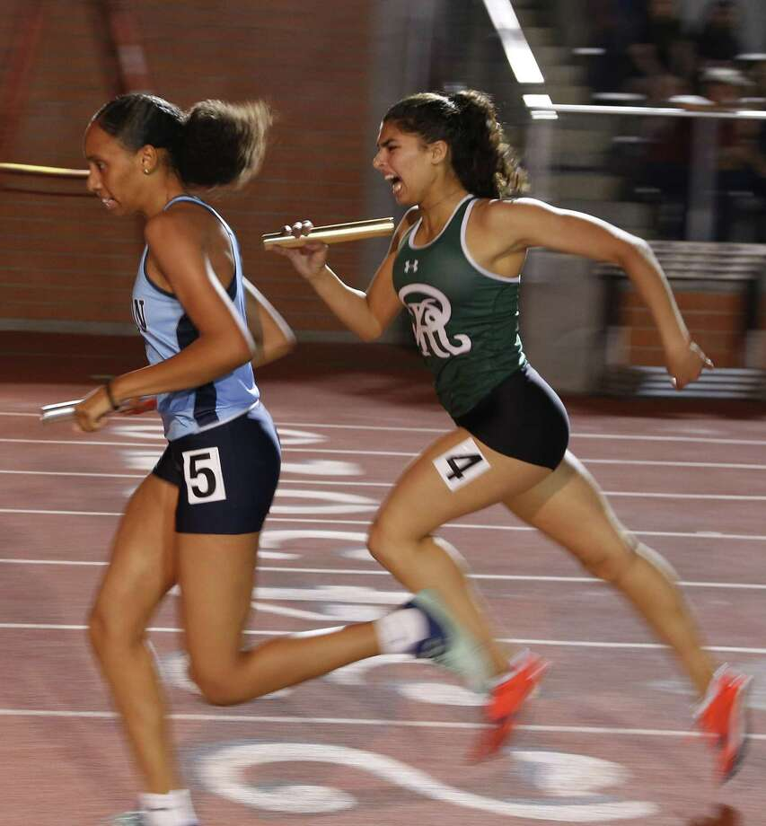 Johnson's Serenity holds off Reagan's Mariana Rodriquez Chavez in 4x400 from the District 26-6A high school track and field meet on Friday, April 6 ,2018 at Heroes Stadium. Photo: Ronald Cortes, For The San Antonio Express News / 2018 Ronald Cortes