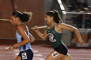 Johnson's Serenity holds off Reagan's Mariana Rodriquez Chavez in 4x400 from the District 26-6A high school track and field meet on Friday, April 6 ,2018 at Heroes Stadium.