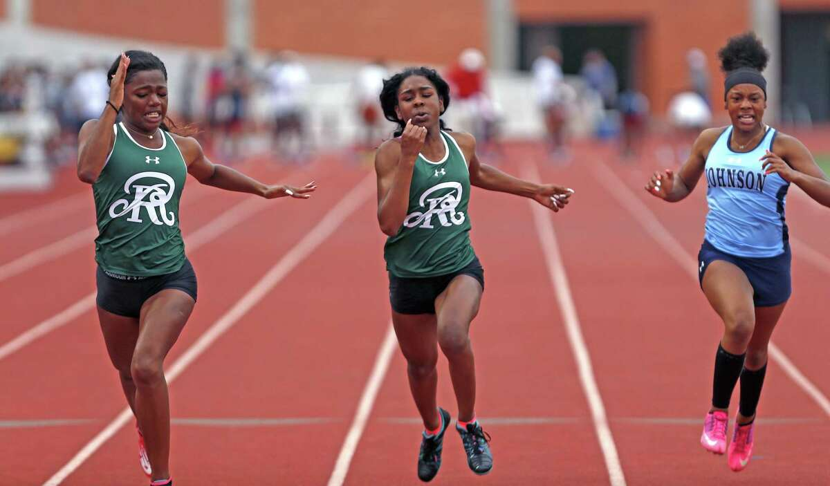 Reagan's Zskaira Williams,L, and Jasmine Montgomery,C, won 1st and 2nd in 100 yard dash, on right is Johnson's Jor'dann Hughes from the District 26-6A high school track and field meet on Friday, April 6 ,2018 at Heroes Stadium.