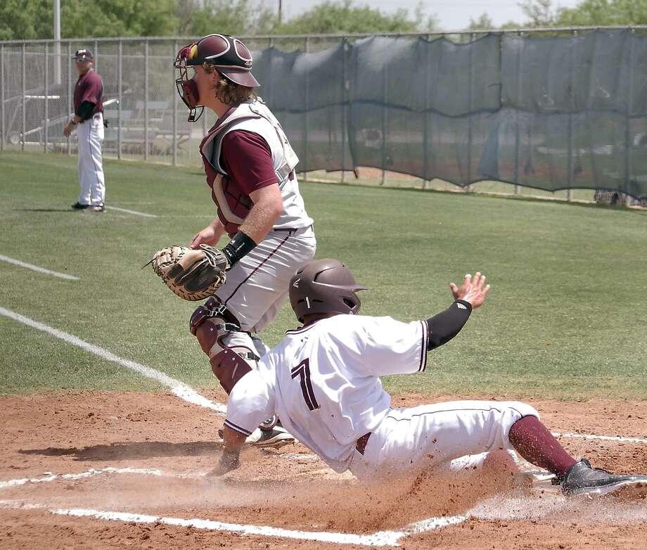 Right fielder Danny Espinosa had the game-winning squeeze bunt in the final inning Saturday helping TAMIU upset St. Edward's 4-3. The win snapped a 15-game losing streak that was one loss shy of tying the school's all-time record. The Dustdevils lost 5-2 in Game 2. Photo: Cuate Santos /Laredo Morning Times File / Laredo Morning Times