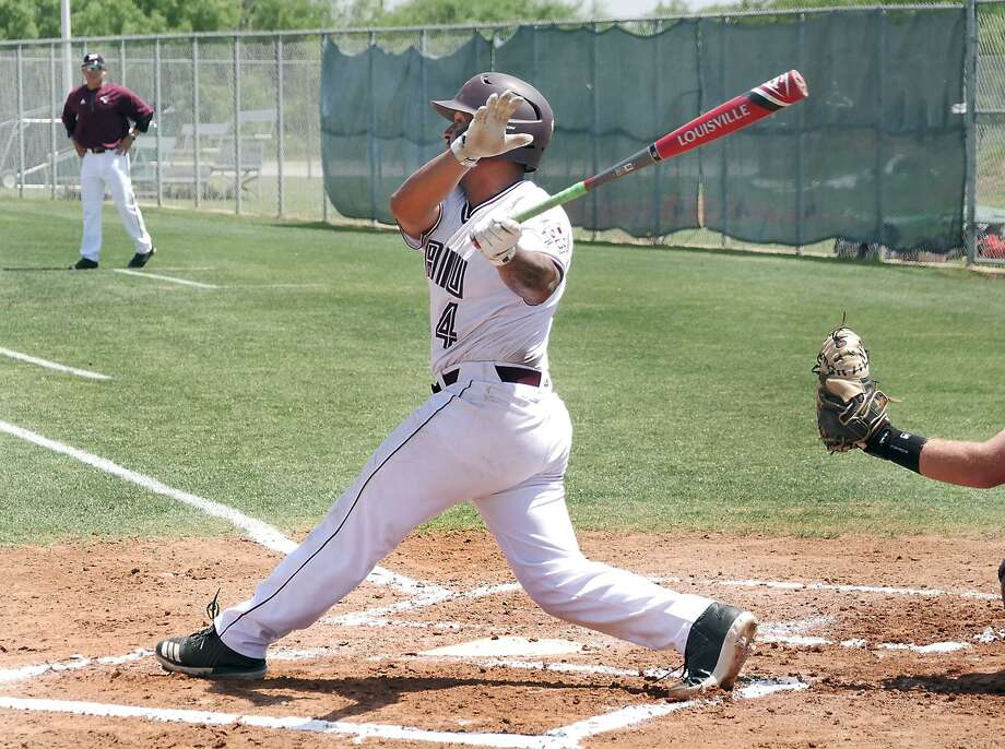 TAMIU first baseman Ricky Gonzalez hit two solo home runs in the Dustdevils' 5-2 loss in Game 2 of a doubleheader Saturday at St. Edward's. TAMIU won the first game 4-3 snapping a 15-game losing skid. Photo: Cuate Santos /Laredo Morning Times File / Laredo Morning Times
