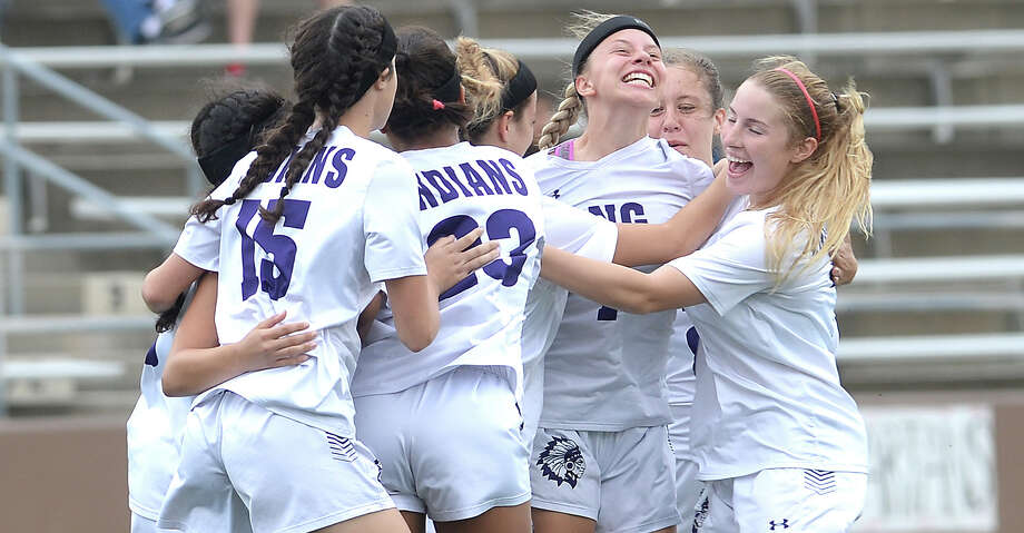 Port Neches - Groves' Jillian Flores (center) is mobbed by teammates after bringing in an early first goal against Porter during their regional quarterfinal match-up at Galena Park. Photo taken Friday, April 6, 2018 Kim Brent/The Enterprise Photo: Kim Brent/Beaumont Enterprise