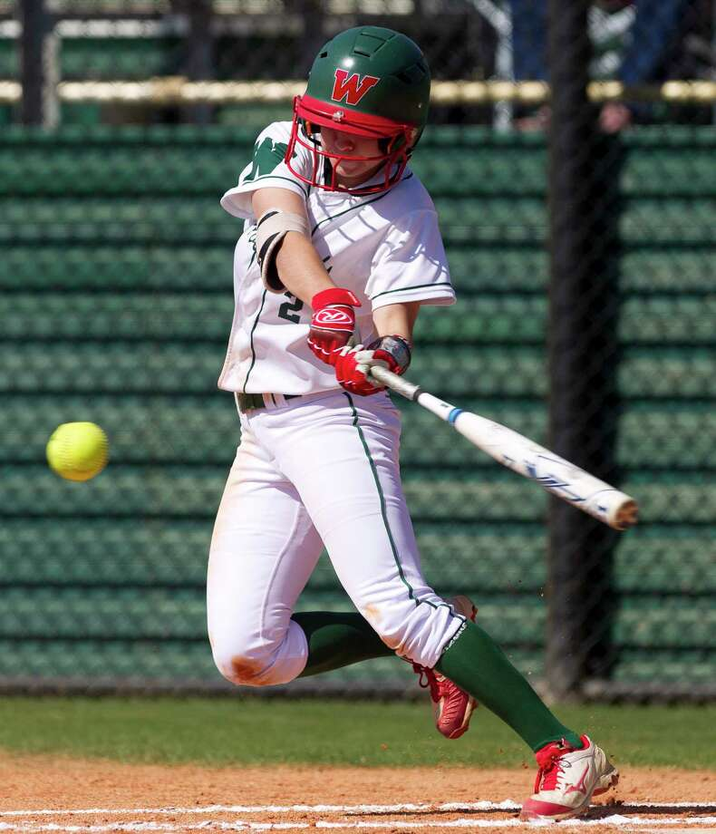 Abby Jones #2 of The Woodlands hits a ground ball during the second inning of a non-district high school softball game at The Woodlands High School, Wednesday, March 14, 2018, in The Woodlands. Photo: Jason Fochtman, Staff Photographer / © 2018 Houston Chronicle
