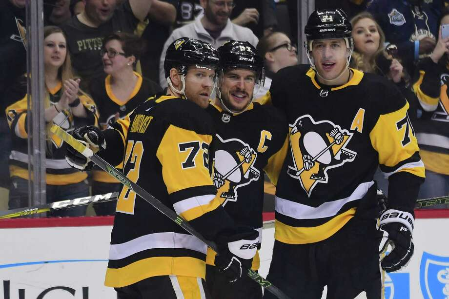 PITTSBURGH, PA - APRIL 06: Sidney Crosby #87 of the Pittsburgh Penguins is congratulated by Patric Hornqvist #72 and Evgeni Malkin #71 after scoring a goal against the Ottawa Senators at PPG PAINTS Arena on April 6, 2018 in Pittsburgh, Pennsylvania. (Photo by Matt Kincaid/Getty Images) Photo: Matt Kincaid / 2018 Getty Images
