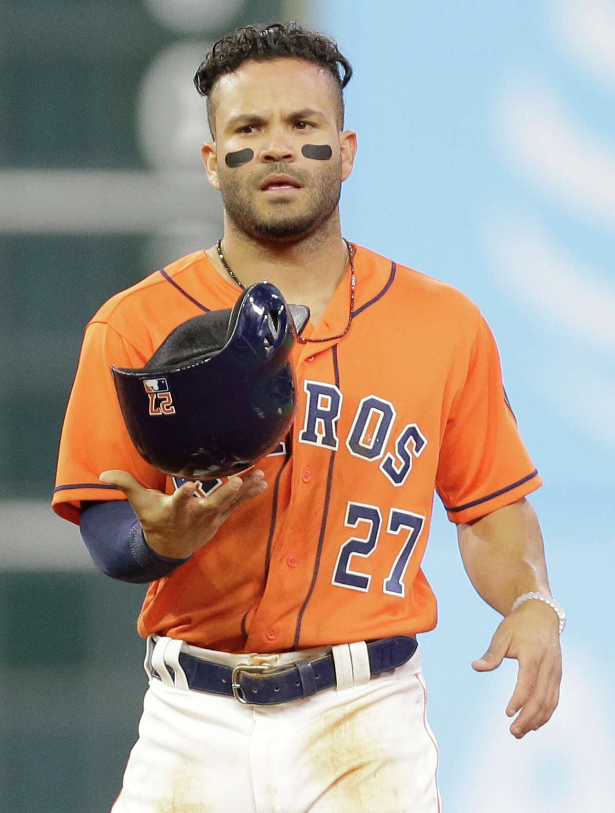 Houston Astros Jose Altuve flips his helmet as he walks back to dugout after the first inning of MLB game against the San Diego Padres at Minute Maid Park Friday, April 6, 2018, in Houston. ( Melissa Phillip / Houston Chronicle )