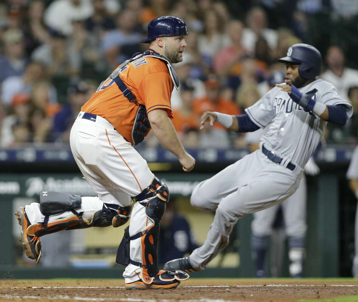 San Diego Padres Manuel Margot past Houston Astros catcher Brian McCann during the fifth inning of MLB game at Minute Maid Park Friday, April 6, 2018, in Houston. ( Melissa Phillip / Houston Chronicle )