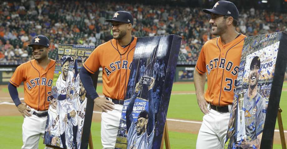 Houston Astros Jose Altuve, left, George Springer, center, and Justin Verlamder, right, pose with their portraits by artist Opie Otterstad presented during pre-game ceremonies before MLB game against the San Diego Padres at Minute Maid Park Friday, April 6, 2018, in Houston. ( Melissa Phillip / Houston Chronicle ) Photo: Melissa Phillip/Houston Chronicle